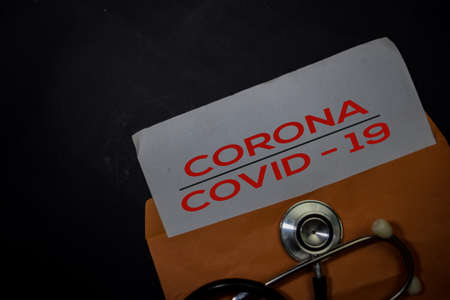 Corona or Covid-19 in brown envelope isolated on Office Desk. Healthcare or Medical Concept Stok Fotoğraf