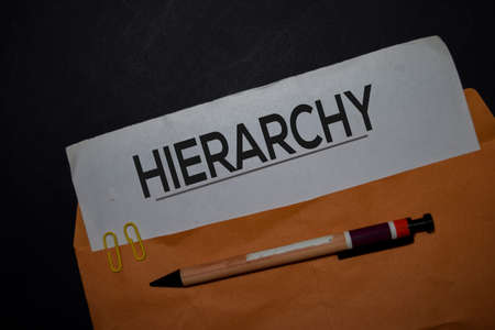 Hierarchy in brown envelope isolated on Office Desk