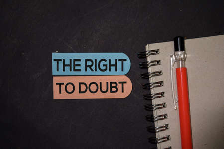 The Right To Doubt write on sticky note isolated on Office Desk