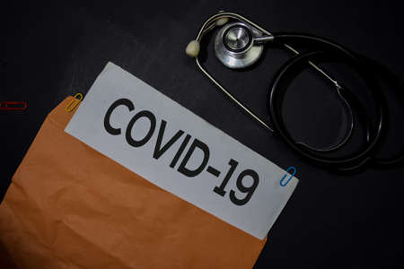 Covid-19 in brown envelope isolated on Office Desk. Healthcare or Medical Concept