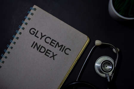 Glycemic Index write on a book isolated on Office Desk. Healthcare or Medical Concept Stok Fotoğraf