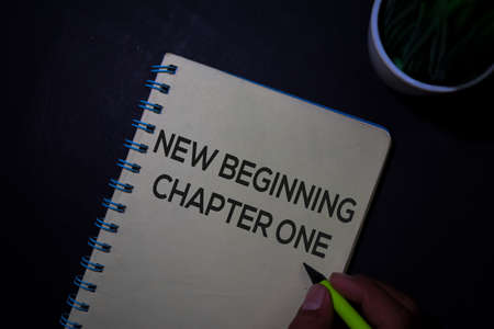 New Beginning Chapter One write on a book isolated on Office Desk