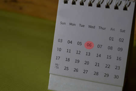 monthly Calendar and marked 8th isolated on office desk