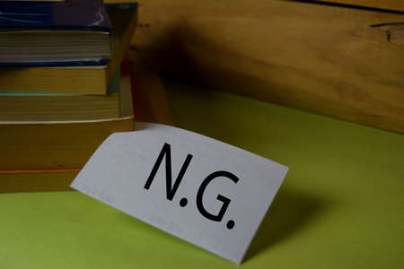 NG write on a sticky note isolated on Office Desk. Business Document concept