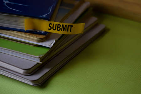 Submit write on a sticky note isolated on Office Desk. Business Document concept Stok Fotoğraf