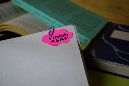 Finish ASAP write on a sticky note isolated on Office Desk. Business Document concept Stok Fotoğraf
