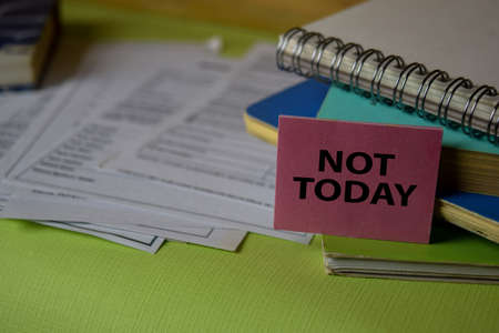 Not Today write on a sticky note isolated on Office Desk. Business Document concept