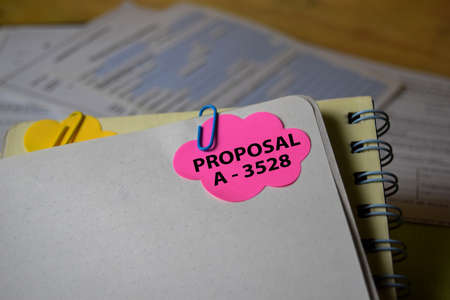Proposal A-3528 write on a sticky note isolated on Office Desk. Business Document concept Stok Fotoğraf