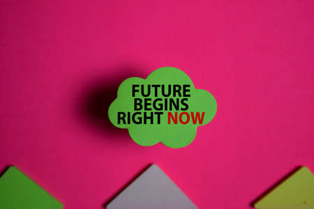 Future Begins Right Now write on a sticky note isolated on Office Desk.