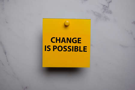 Change Is Possible write on sticky note isolated on Office Desk