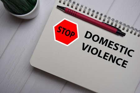 Stop Violence Domestic write on a book isolated on Office Desk. Zdjęcie Seryjne