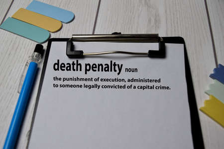 Definition of Death Penalty word with a meaning on a book. dictionary concept