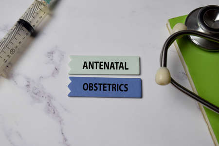 Antenatal Obstetrics text on Sticky Notes. Top view isolated on office background. Healthcare/Medical concept