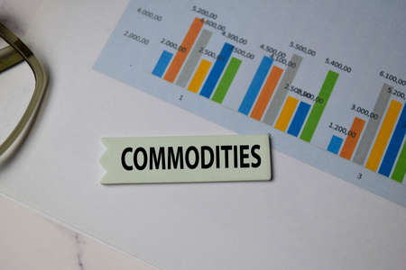 Commodities write on sticky note isolated on Office Desk
