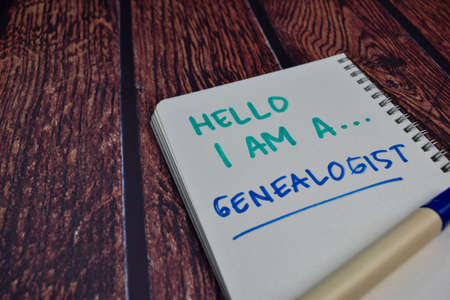 Hello I am A Genealogist write on a book Isolated on wooden table background 版權商用圖片