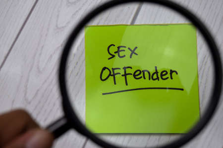Sex Offender write on sticky notes. Isolated on white table background
