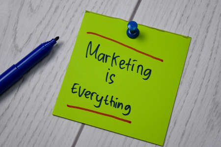 Marketing Is Everything write on a book isolated on wooden table. Stok Fotoğraf