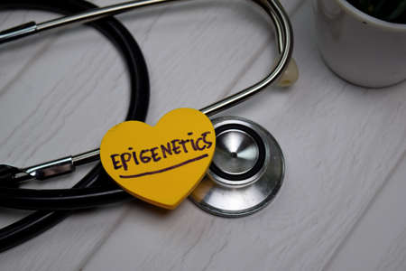 Epigenetics write on sticky note isolated on wooden table. Medical concept Banque d'images