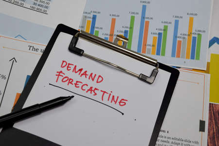 Demand Forecasting write on paperwork isolated on wooden table. Foto de archivo