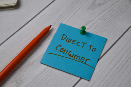 Direct To Consumer - DTC text on sticky notes isolated on office desk