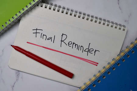 Final Reminder write on a book isolated wooden table.