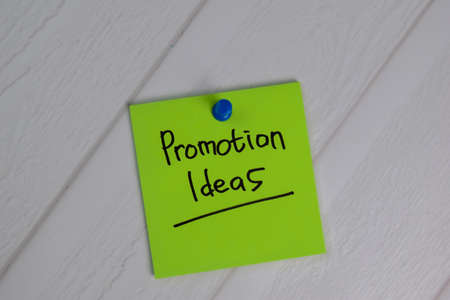 Promotion Ideas write on sticky notes isolated on office desk.