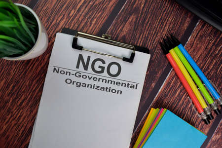 NGO - Non-Governmental Organization text write on a paperwork isolated on office desk. 免版税图像