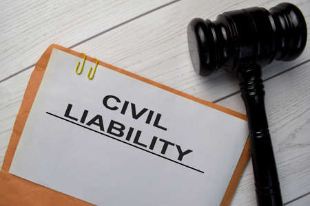 Civil Liability text with document brown envelope and gavel isolated on office desk.