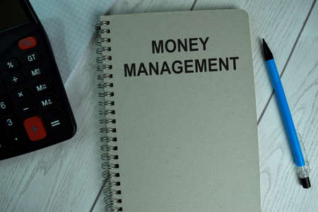 Money Management write on a book isolated on office desk. Stock fotó
