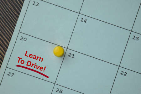 Learn to Drive on monthly Calendar and marked 20th isolated on the table