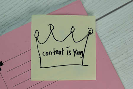 Content is King write on sticky note isolated on Wooden Table. Stok Fotoğraf