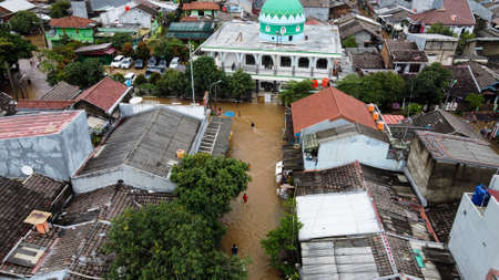Aerial POV view Depiction of flooding. devastation wrought after massive natural disasters. BEKASI, WEST JAVA, INDONESIA. FEBRUARY 23, 2021