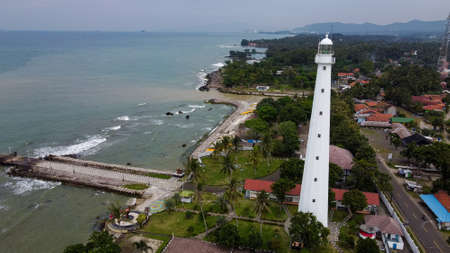 Aerial view of Karang Bolong Beach and Its Wonderful Sunset View. At anyer beach with noise cloud and cityscape. Banten, Indonesia, March 3, 2021