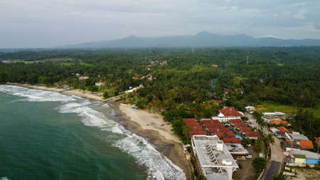 Aerial view of Karang Bolong Beach and Its Wonderful Sunset View. At anyer beach with noise cloud and cityscape. Banten, Indonesia, March 3, 2021 Éditoriale