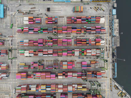 Aerial view of Container ship loading and unloading in deep sea port, logistic import and export freight transportation by container ship in open sea at night. Jakarta, Indonesia, April 12, 2021