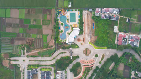 Bekasi, Indonesia, May 8, 2021 : Aerial view of Beautiful umbrella around outdoor swimming pool in hotel resort for vacation travel at Bekasi
