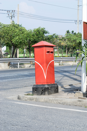 post box: public post box service for people on walk way and road Stock Photo