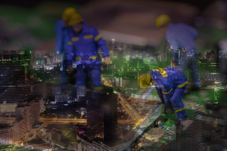 tage: double exposure of mini worker and urban cityscape - can use to display or mon tage on product