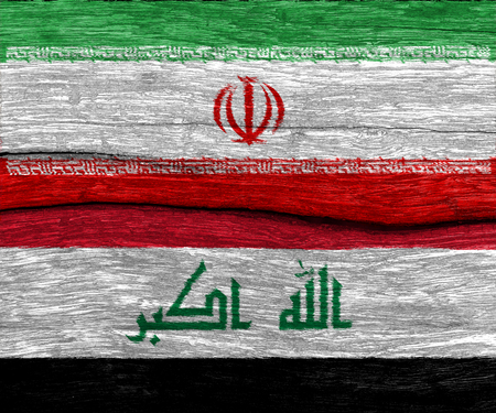 iraqi: Iran and Iraq flag on old wood texture pattern background Stock Photo