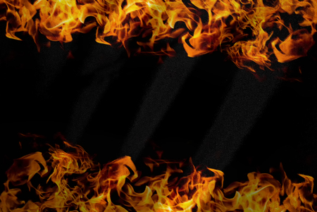 blazed: abstract frame of fire on black fabric background - can use to display or montage on product Stock Photo