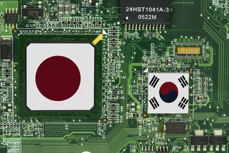 japan and south korea flag on green used mainboard texture background - can use to display or montage on products Stok Fotoğraf