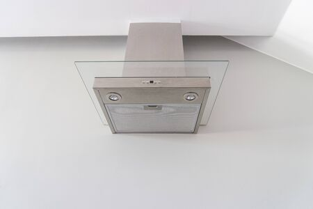 stainless steel range: hood cooking on white wall for manage smell in kitchen - can use to display or montage on product