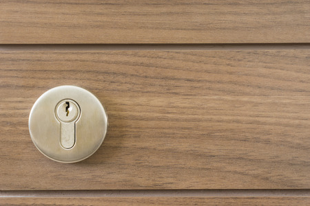 key cabinet: abstract space silver keyway on wood door close-up - can use to display or montage on product Stock Photo