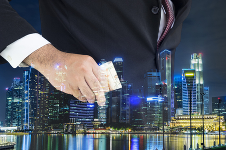 people in action: double exposure power of money and night cityscape - can use to display or montage on product