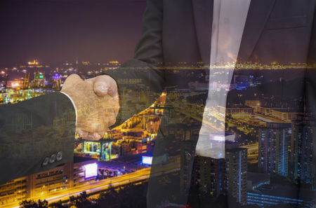 commit: double exposure scene of businessman shakehand for commit industry cityscape - can use to display or montage on product
