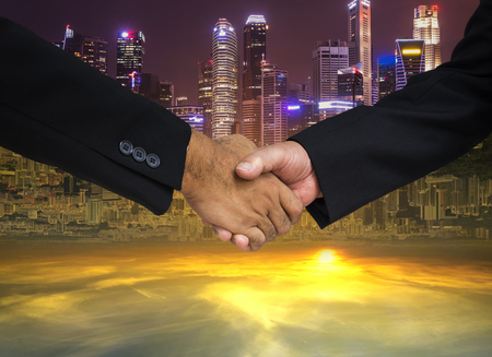 double side of cityscape background for commitment hand shake in business concept - can use to display or montage on product Stock Photo