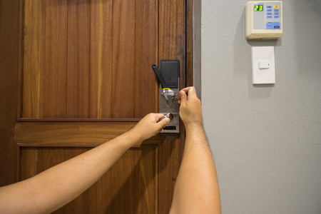 locksmith fix electronic lock on wood door and modern handle