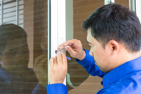 locksmith service for open door when key lost focus on lockpicker - can use to display or montage on product Standard-Bild - 109542809