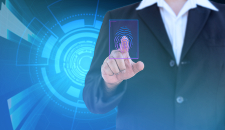 businessman scan fingerprint for biometric authentication and blue hi-tech background - can use to display or montage on product Stock Photo