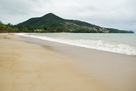 The lonely beach and sea with cloudy in thailand photo